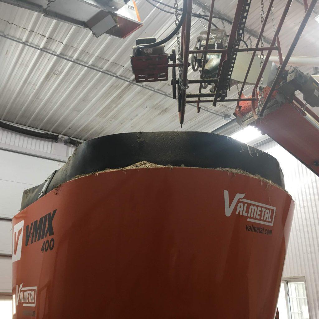 Installation de vis à grain et convoyeur pour mélangeur